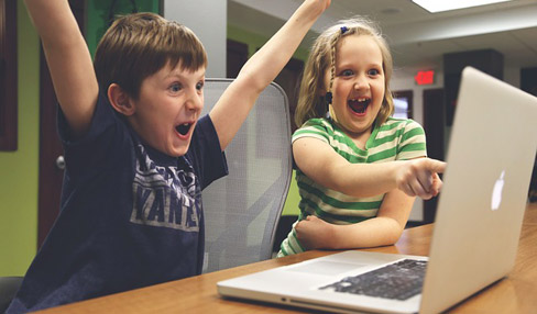 Excited kids on laptop