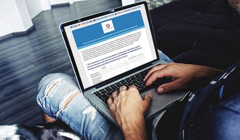 Man taking survey on laptop