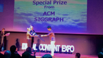 Jacki Morie presents the ACM SIGGRAPH Special Prize at DCAJ