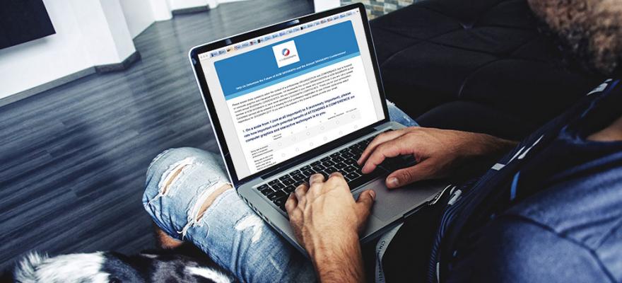 Man on laptop taking the ACM SIGGRAPH survey
