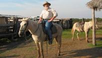 Steve on horseback in Brazil, 2003